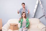 Young couple showing keys to new home