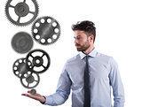 Businessman holds a gear system. Concept of business mechanism