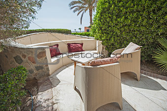 Patio area with sofa seating area and table at a luxury tropical