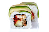 Traditional fresh japanese sushi rolls on a white background, close-up, selective focus.