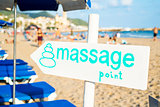 text massage point in a signpost on the beach