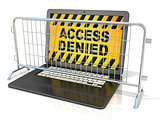 Black laptop with ACCESS DENIED sign on screen, and steel barric