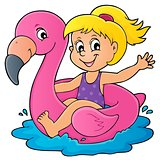 Girl floating on inflatable flamingo 1