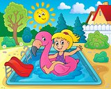 Girl floating on inflatable flamingo 2
