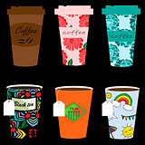 Paper coffee cup set on a black background.