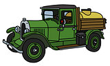 The vintage green tank truck