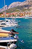 Colorful Makarska boats and waterfront under Biokovo mountain vi
