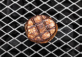 Grilled juicy beef pork steak on barbecue mesh