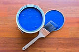 Top View of Blue Paint Can and Brush