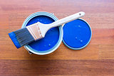 Top View of Blue House Paint Can and Brush