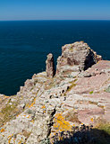 Pink limestone cliffs of Cap Frehel, Brittany, France