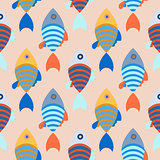 Seamless pattern with school of fish bright background.