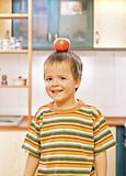 Boy balancing an apple