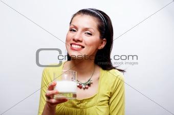 beautiful causacian woman with glass of milk