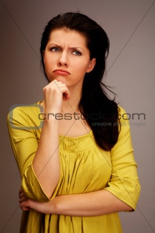 pensive woman over grey