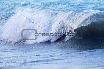 Wave in stormy ocean