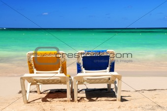 Chairs on sandy beach