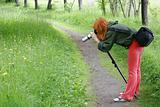 girl taking macro photo in park