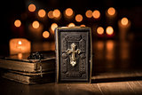 Antique precious Bible and Holy rosary in the Church
