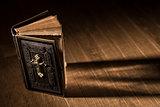 Precious antique Bible on a wooden desktop