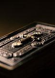 Precious antique Bible with golden cross close up