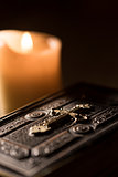 Precious old Bible and lit candles in the Church