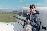 Photographer posing with a light aircraft