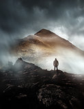 Man Hiking On A Misty Mountain