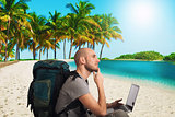 Explorer plans a new travel to a tropical beach with his laptop