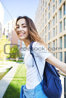 portrait of a young attractive woman on the cityscape background