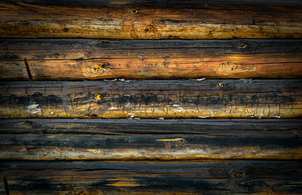 Old wooden wall of logs for background.