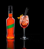 A liquor bottle and a cup of Spritz, typical Italian cocktail.