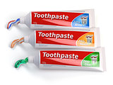 Tubes of toothpaste in different colors and differnt types of to
