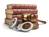 Judge gavel and handcuffs with legal book isolated on white back