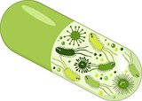 Capsules with green probiotics bacteria. Concept of healthy nutrition ingredient for therapeutic purposes.
