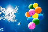 Colorful Balloons over Sun and Sky