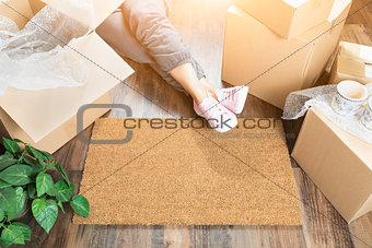 Woman Wearing Sweats Relaxing Near Home Sweet Home Welcome Mat,