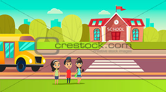 Pupils are near the school bus. School across the road. Transition in front of the school. Students are going to learn. Back to school concept.