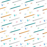 Flat lay with bright stationery supplies on white background. Seamless pattern.