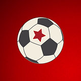 Soccer football with red star on red