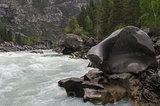 Bizarre stone on the shore of a mountain river.  Altai Mountains