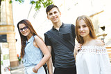 happy friends students perfectly spend time together on a walk on the street