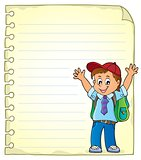 Notepad page with happy pupil boy