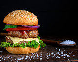 double burger with cheese, black background