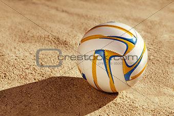white ball on sand