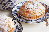 Delicious tartlets with almonds and cream mascaropne on plate