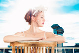 Bride with bridal lingerie sitting on balcony
