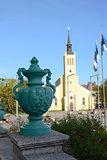 Green urn in front of St John's Church, Tallinn, Estonia