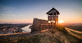 Wooden Tourist Observation Tower above a Little City with River