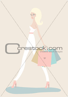 Young beautiful woman with shopping bags on light background